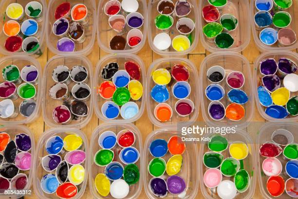 Vividly Colored Acrylic or Tempera Paints in Cups, Overhead View