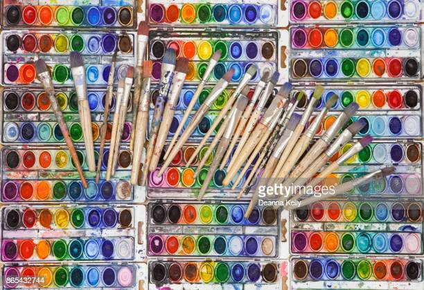 Vividly Colored Watercolor Pans with Artist Paintbrushes
