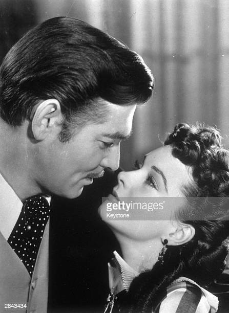 Vivien Leigh and Clark Gable as Scarlett O'Hara and Rhett Butler in the MGM epic 'Gone with the Wind' directed by Victor Fleming for MGM