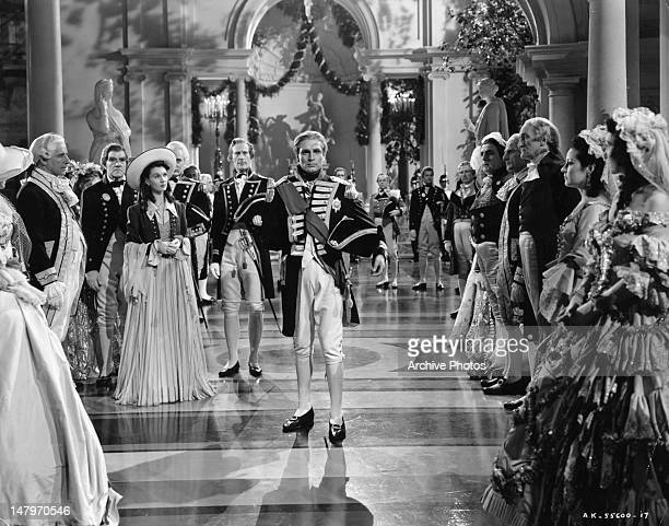 Vivien Leigh and others participate in gala celebration for Laurence Olivier in a scene from the film 'That Hamilton Woman' 1941