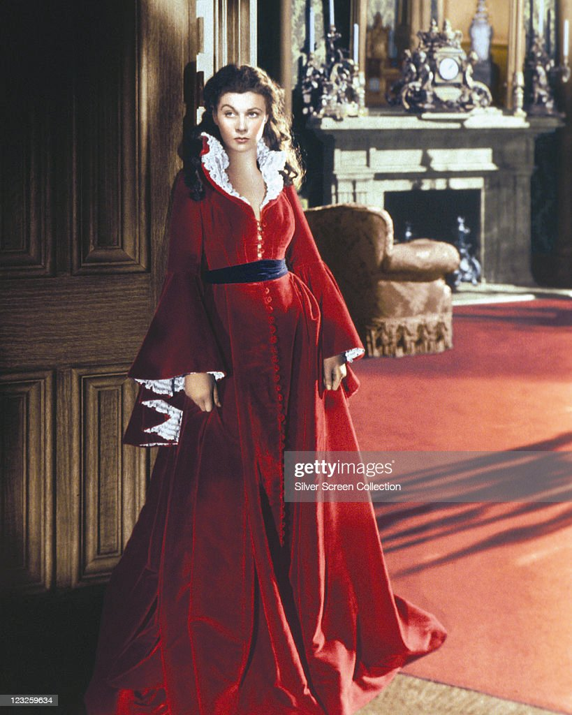 Vivien Leigh (1913-1967), British actress, wearing a long red dress trimmed with white lace, with a black belt, in a publicity portrait issued for the film, 'Gone with the Wind', 1939. The historical epic, adapted from the novel by Margaret Mitchell (1900-1949) and directed by Victor Fleming (1889-1949), starred Leigh as 'Scarlett O'Hara'.