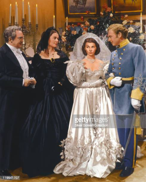 Vivien Leigh British actress wearing a wedding dress and Thomas Mitchell US actor in uniform in a publicity still issued for the film 'Gone with the...