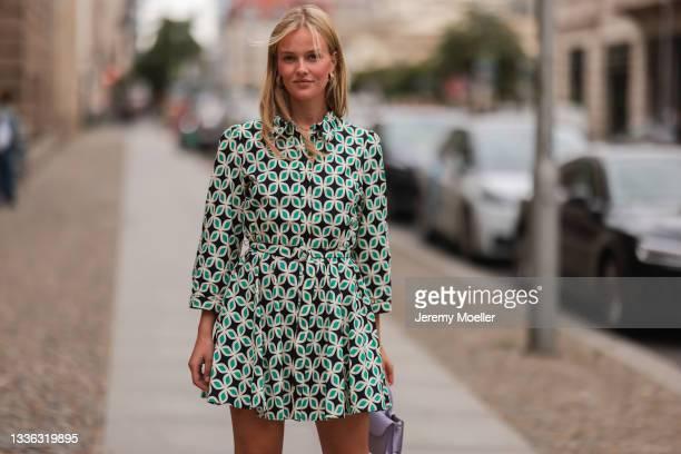 Vivien Wysocki wearing Zara mini green flower dress and Zara lilac bag on August 18, 2021 in Berlin, Germany.