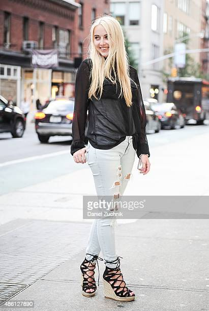 Vivienne is seen in Soho wearing Zara pants Jaeger blouse and Steve Madden wedges on August 31 2015 in New York City