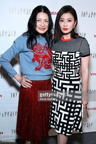 Vivienne Tam and Alyssa Chia pose backstage at the Vivienne Tam Fall 2016 fashion show during New York Fashion Week The Shows at The Arc Skylight at...