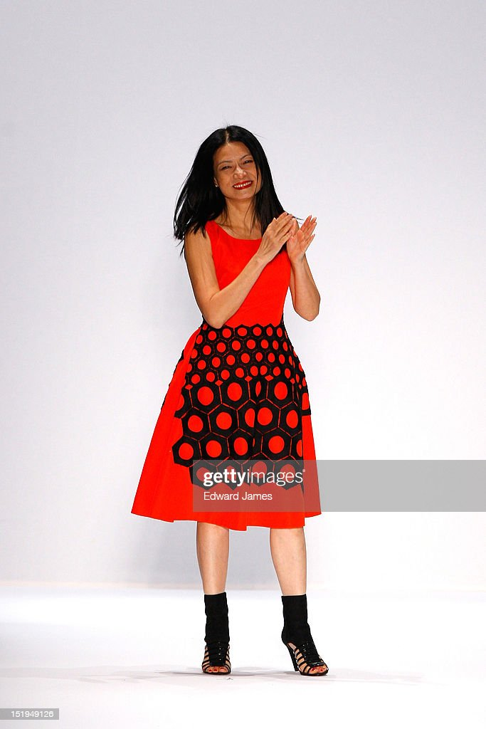 Vivienne Tam walks the runway during the Vivienne Tam show during Spring 2013 Mercedes-Benz Fashion Week at The Stage Lincoln Center on September 12, 2012 in New York City.