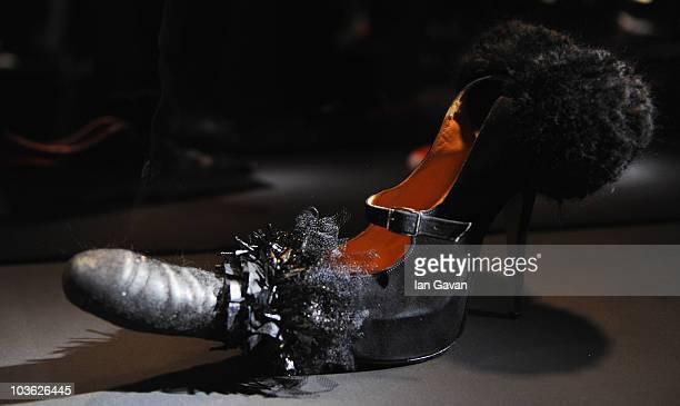 Vivienne Westwood designed Penis Shoe from 1995 is displayed prior to 'Vivienne Westwood Shoes An Exhibition 1973 2010' at Selfridges Ultra Lounge on...