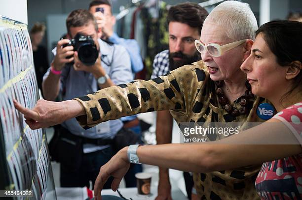 Vivienne Westwood works on her model board backstage at her Vivienne Westwood Red Label show during London Fashion Week Spring Summer 2015 on...