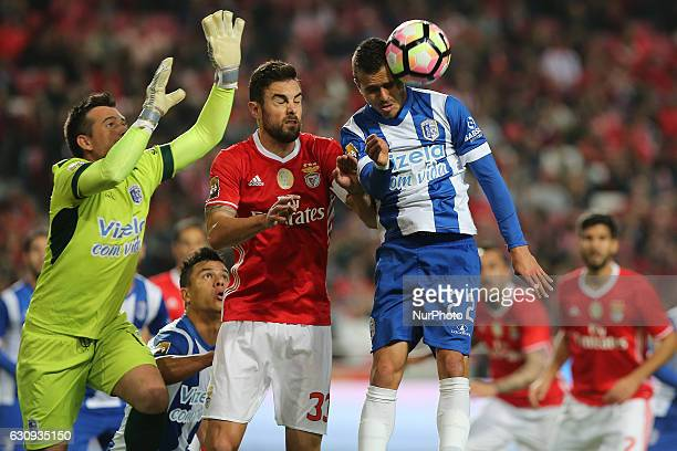 Vizelas goalkeeper Pedro Albergaria from Portugal with Benficas defender Jardel from Brazil and Vizelas defender Dani Coelho from Portugal during the...