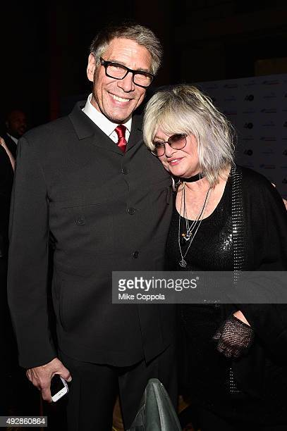 VJs Mark Goodman and Nina Blackwood attend the TJ Martell 40th Anniversary NY Gala at Cipriani Wall Street on October 15 2015 in New York City