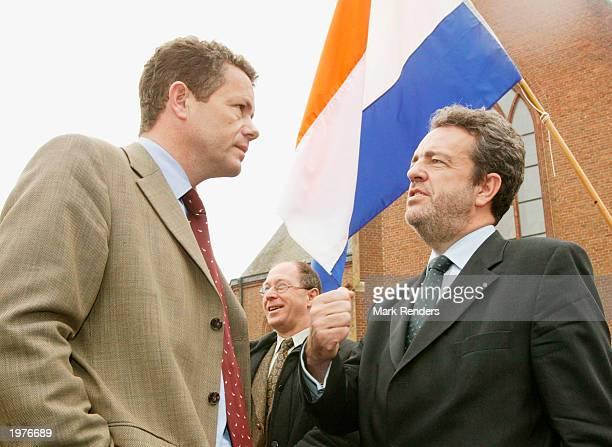 Vlaams Blok Senator Gerolf Annemans and Vlaams Blok Chairman Frank Van Hecke talk during a memorial for Dutch politician Pim Fortuyn May 6 2003 at...