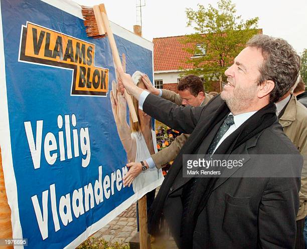 Vlaams Blok Senator Gerolf Annemans posts a campaign poster for the upcoming Belgian elections following a memorial for Dutch politician Pim Fortuyn...