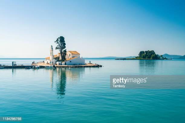 vlacherna monastery, rat island on background, corfu, kerkira, greece - corfu stock pictures, royalty-free photos & images