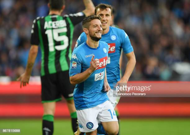 Vlad Chiriches and Dries Mertens of SSC Napoli celebrate the 31 goal scored by Dries Mertens during the Serie A match between SSC Napoli and US...