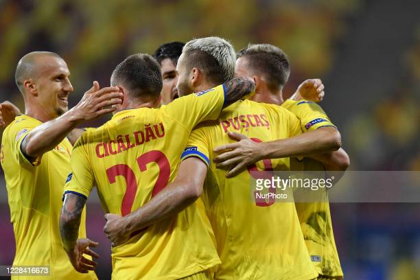 Vlad Chiriches and George Puscas of Romania celebrate during UEFA Nations League 2021 match between Romania and Northern Ireland at Arena Nationala,...