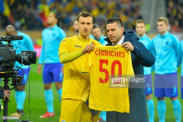 Vlad Chiriches celebrating hos 50th match for the Romanian national team with Romania's coach Cosmin Contra before the International Friendly match...