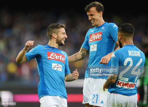 Vlad Chiriches Dries Mertens and Lorenzo Insigne of SSC Napoli celebrate the 31 goal scored by Dries Mertens during the Serie A match between SSC...