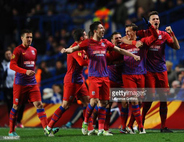 Vlad Chiriches of FC Steaua Bucuresti celebrates with team mates after scoring their first goal during the UEFA Europa League Round of 16 Second leg...