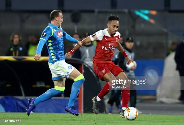 Vlad Chiriches of Napoli and PierreEmerick Aubameyang of Arsenal during the UEFA Champions League quarterfinals second leg football match SSC Napoli...