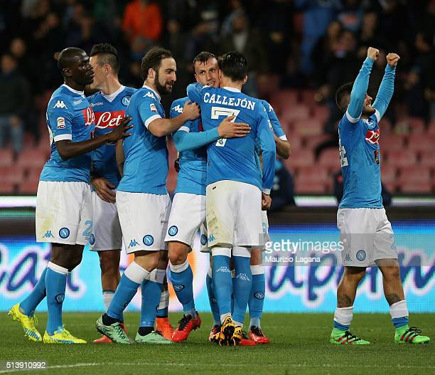 Vlad Chiriches of Napoli celebrates his team's second goal during the Serie A match between SSC Napoli and AC Chievo Verona at Stadio San Paolo on...