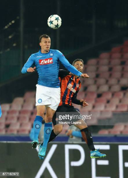 Vlad Chiriches of Napoli competes for the ball in air with Marlos of Shakhtar Donetsk during the UEFA Champions League group F match between SSC...