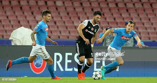 Vlad Chiriches of Napoli competes for the ball with Tolgay Arslan of Besiktas during the UEFA Champions League match between SSC Napoli and Besiktas...