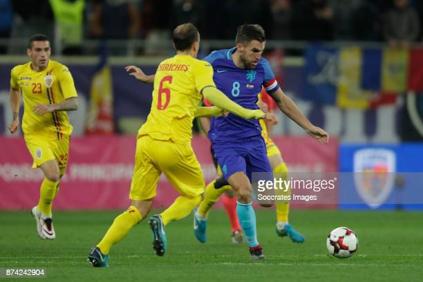 Vlad Chiriches of Romania Kevin Strootman of Holland during the International Friendly match between Romania v Holland at the Arena Nationala on...