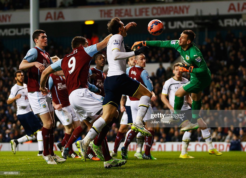 Vlad Chiriches of Spurs beats goalkeeper Thomas Heaton of Burnley to score their third goal during the FA Cup Third Round Replay match between Tottenham Hotspur and Burnley at White Hart Lane on January 14, 2015 in London, England.