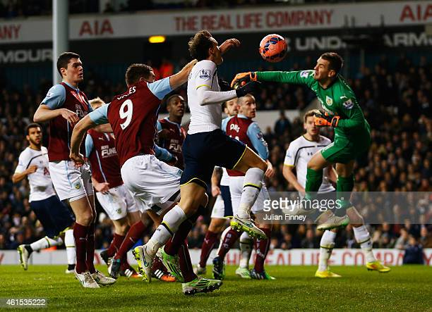 Vlad Chiriches of Spurs beats goalkeeper Thomas Heaton of Burnley to score their third goal during the FA Cup Third Round Replay match between...