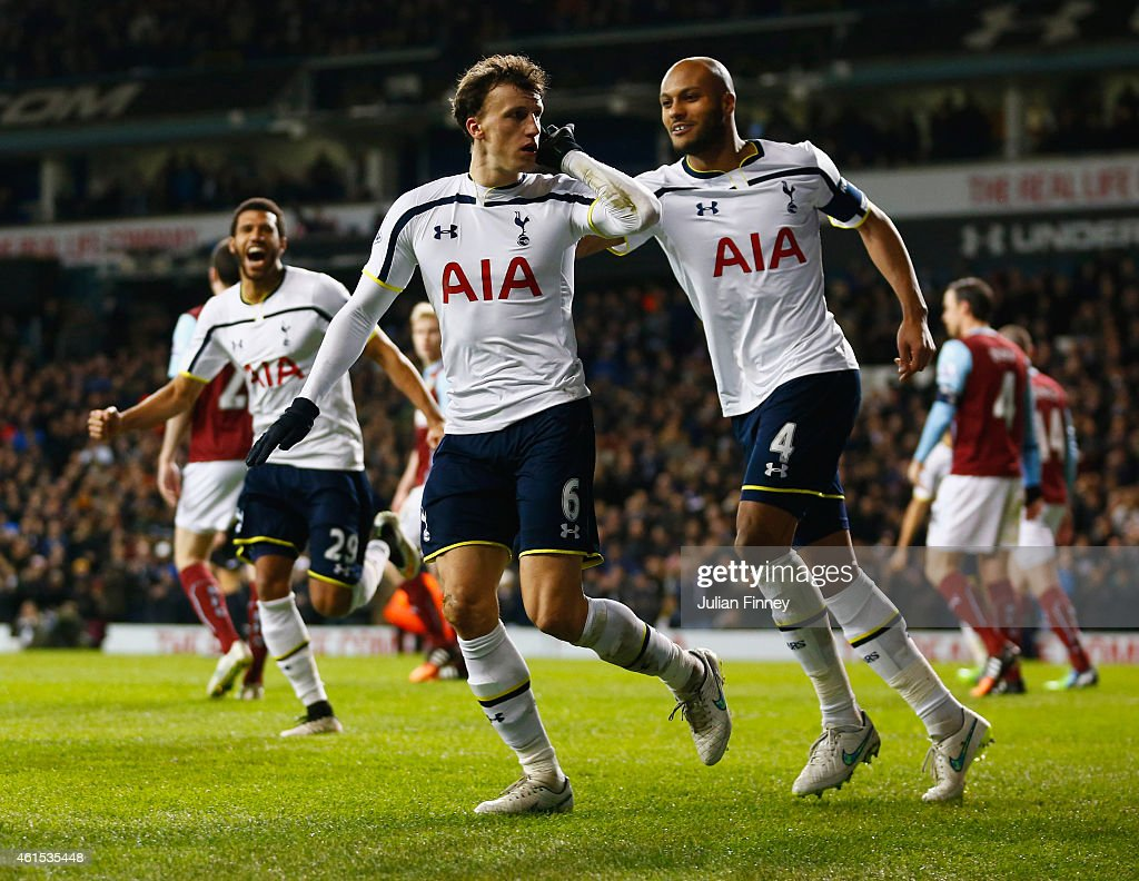 Vlad Chiriches of Spurs (6) celebrates with team mate Younes Kaboul as he scores their third goal during the FA Cup Third Round Replay match between Tottenham Hotspur and Burnley at White Hart Lane on January 14, 2015 in London, England.