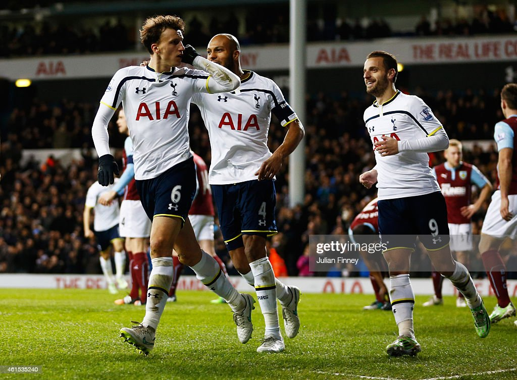 Vlad Chiriches of Spurs (6) celebrates with team mates as he scores their third goal during the FA Cup Third Round Replay match between Tottenham Hotspur and Burnley at White Hart Lane on January 14, 2015 in London, England.