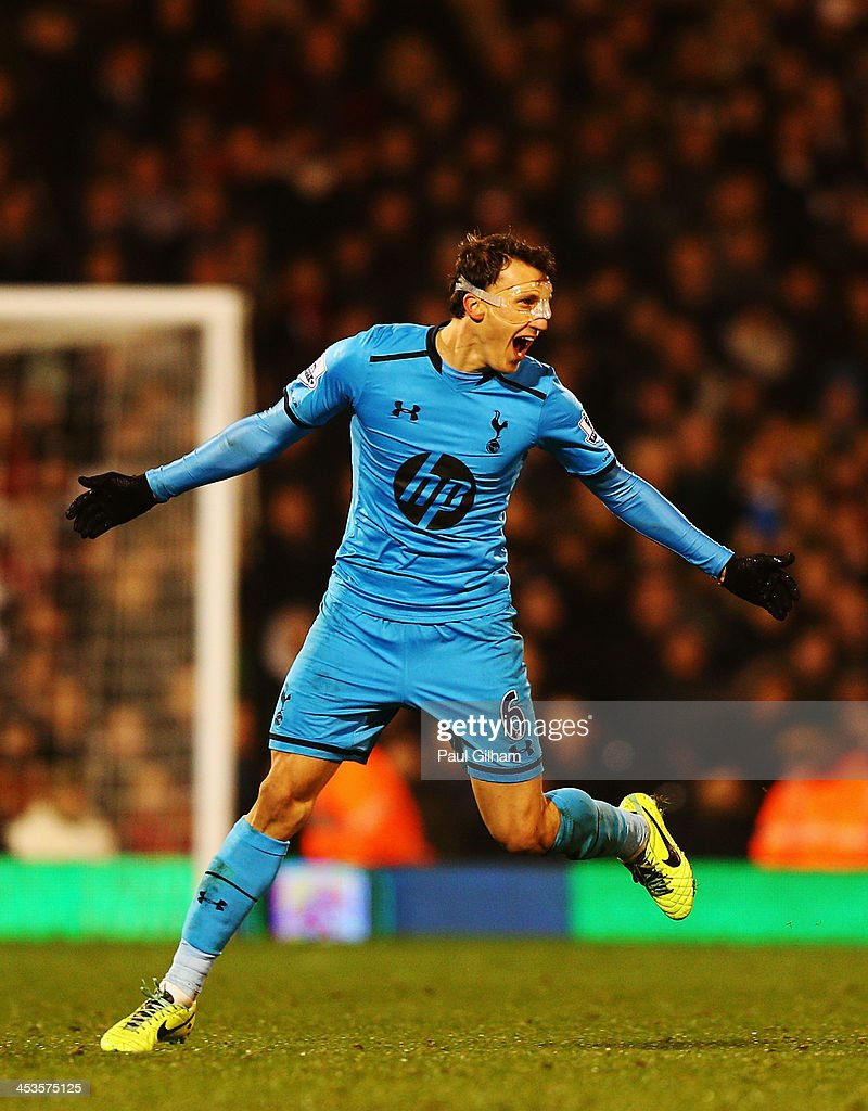 Vlad Chiriches of Tottenham Hotspur celebrates equalising during the Barclays Premier League match between Fulham and Tottenham Hotspur at Craven Cottage on December 4, 2013 in London, England.