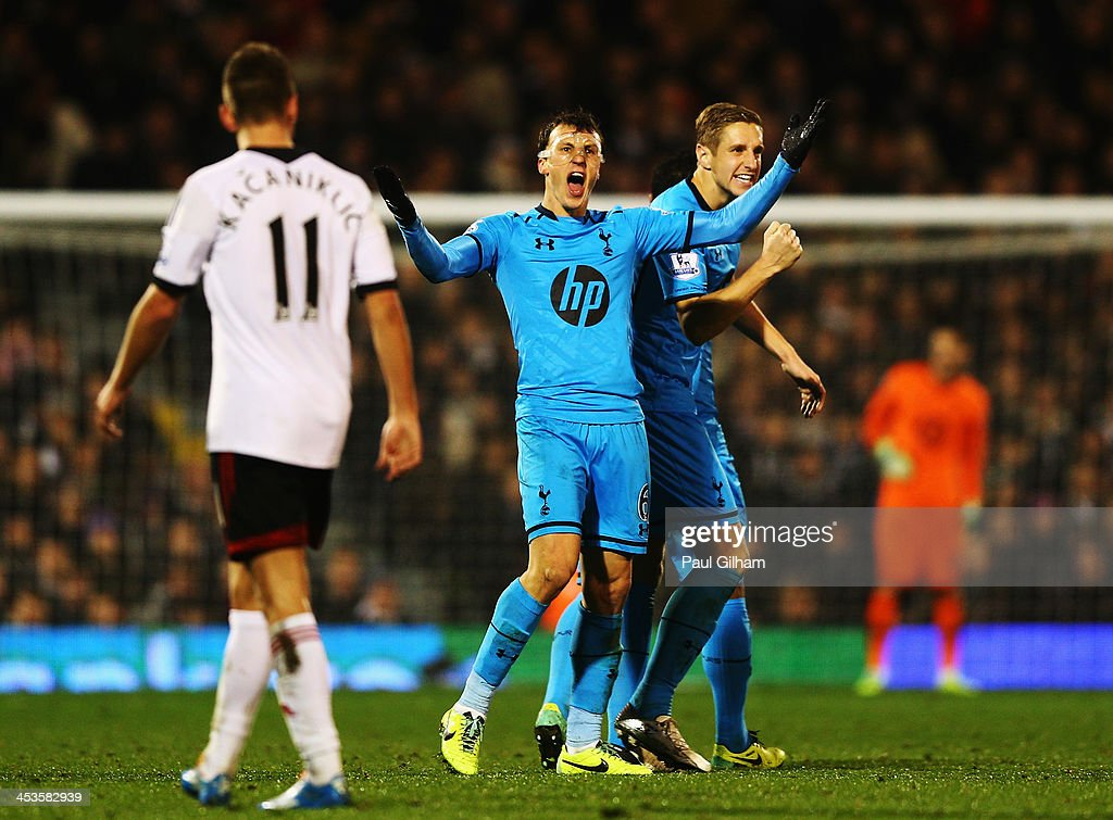 Vlad Chiriches (C) of Tottenham Hotspur celebrates with team mate Michael Dawson (R) after equalising during the Barclays Premier League match between Fulham and Tottenham Hotspur at Craven Cottage on December 4, 2013 in London, England.