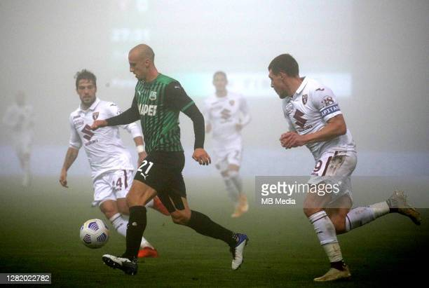 Vlad Chiriches of US Sassuolo competes for the ball with Andrea Belotti and Simone Verdi of Torino FC during the Serie A match between US Sassuolo...