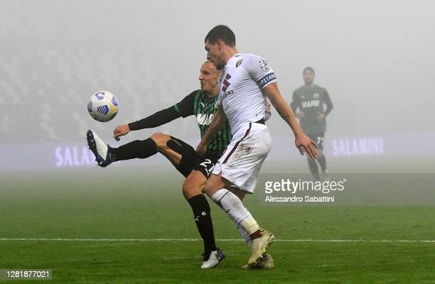 Vlad Chiriches of US Sassuolo competes for the ball with Andrea Belotti of Torino FC during the Serie A match between US Sassuolo and Torino FC at...