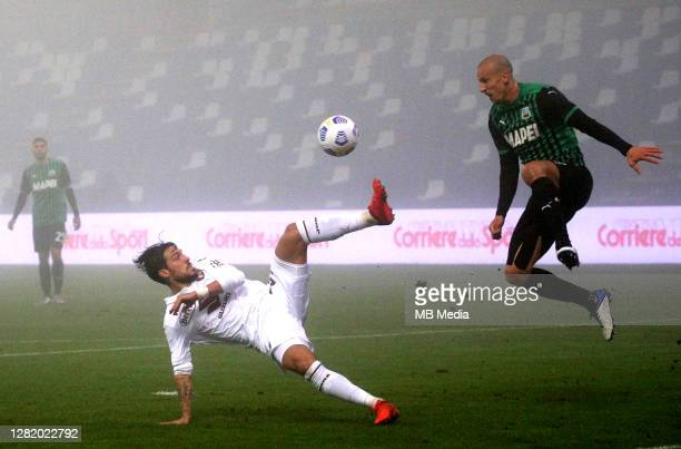 Vlad Chiriches of US Sassuolo competes for the ball with Simone Verdi of Torino FC during the Serie A match between US Sassuolo and Torino FC at...