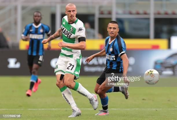 Vlad Chiriches of US Sassuolo is challenged by Alexis Sanchez of FC Internazionale during the Serie A match between FC Internazionale and US Sassuolo...