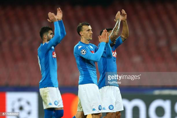 Vlad Chiriches with Elsed Hysaj and Allan Loudeiro getting the supporters at San Paolo Stadium in Naples Italy on November 21 during the UEFA...