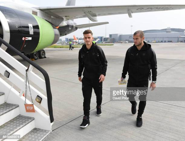 Vlad Dragomir and Jack Wilshere of Arsenal boards the plane at Luton Airport on September 27 2017 in Luton England