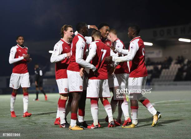 Vlad Dragomir celebrates scoring his and Arsenal's 2nd goal with his team mates during the Premier League Two match between Arsenal U23 and West Ham...