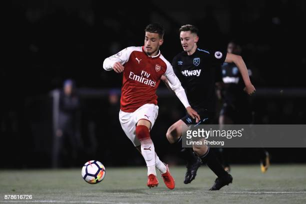 Vlad Dragomir of Arsenal and Ben Wells of West Ham in action during the Premier League 2 match between Arsenal and West Ham United at Meadow Park on...
