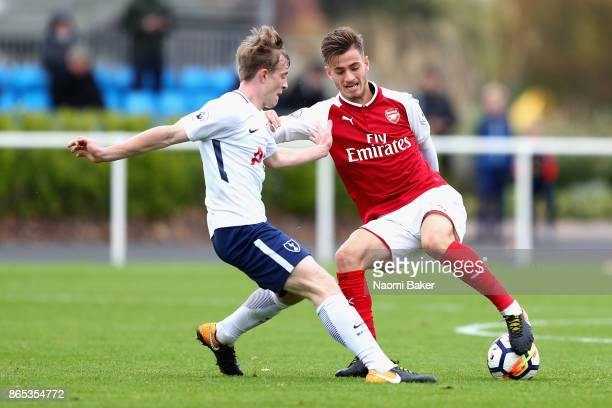 Vlad Dragomir of Arsenal and Oliver Skipp of Tottenham Hotspur battle for posession during a Premier League 2 match between Tottenham Hotspur and...