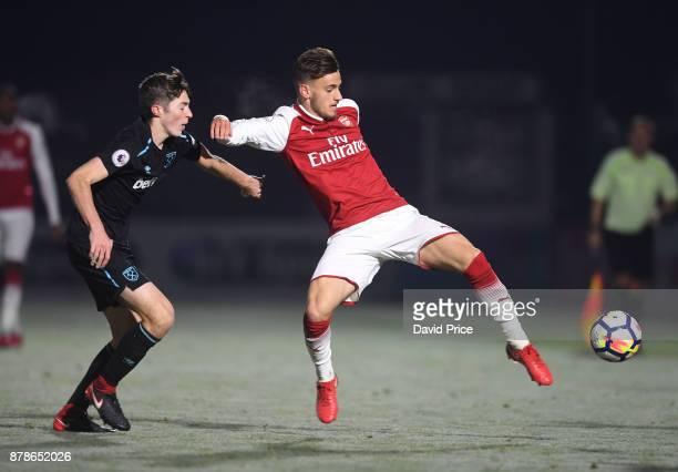 Vlad Dragomir of Arsenal controls the ball under pressure from Conor Coventry of West Ham during the Premier League Two match between Arsenal U23 and...