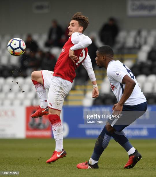 Vlad Dragomir of Arsenal controls the ball under pressure from Japhet Tanganga of Tottenham during the match between Arsenal and Tottenham Hotspur at...