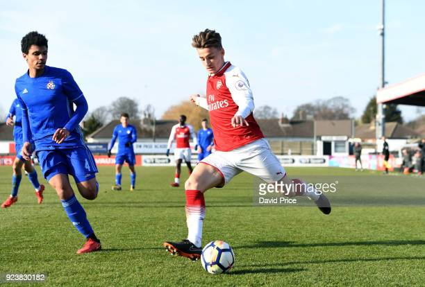 Vlad Dragomir of Arsenal crosses under pressure from K Darcik Morris of Dinamo during the match between Arsenal and Dinamo Zagreb at Meadow Park on...