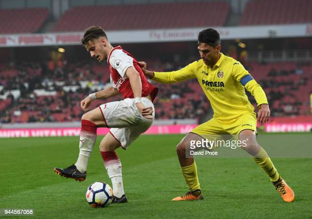 Vlad Dragomir of Arsenal is challenged by Juan Fernandez Blanco of Villarreal during the match between Arsenal U23 and Villarreal U23 at Emirates...