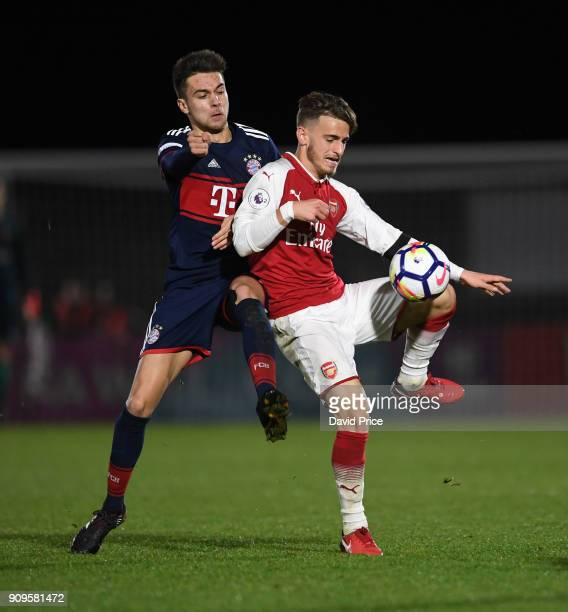 Vlad Dragomir of Arsenal is challenged by Milos Pantovic of Bayern during the Premier League International Cup Match between Arsenal and Bayern...