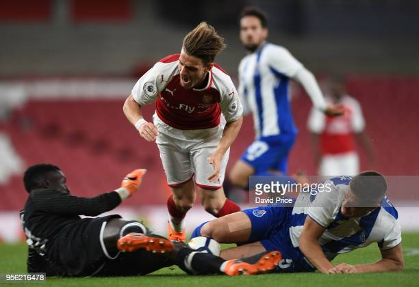 Vlad Dragomir of Arsenal is challenged by Mouhamed Mbaye and Diogo Queiros of Porto during the match between Arsenal and FC Porto at Emirates Stadium...