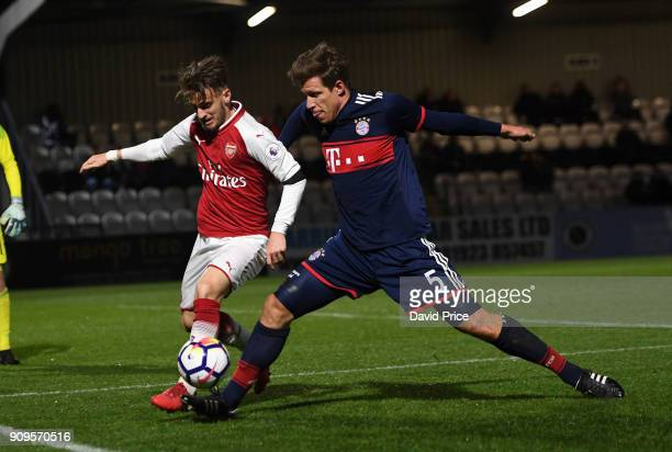 Vlad Dragomir of Arsenal is challenged by Nicolas Feldhahn of Bayern during the Premier League International Cup Match between Arsenal and Bayern...