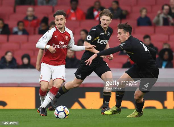 Vlad Dragomir of Arsenal is closed down by Jack Evans of Swansea during the match between Arsenal U23 and Swansea U23 at Emirates Stadium on April 13...